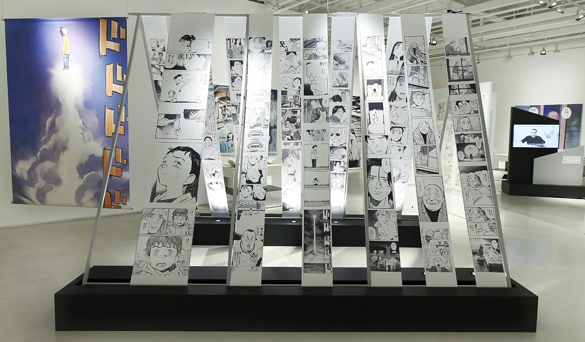 """""""This is MANGA – The Art of NAOKI URASAWA,"""" exhibition at JAPAN HOUSE Los Angeles. (Photo by Ryan Miller/JAPAN HOUSE Los Angeles)"""